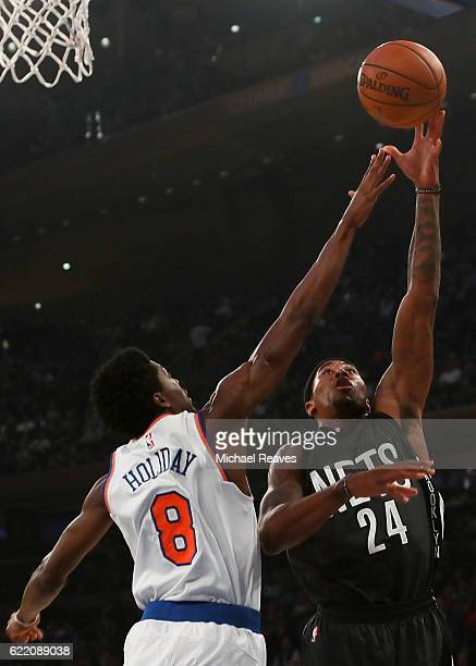 Rondae HollisJefferson of the Brooklyn Nets shoots a layup over Justin Holiday of the New York Knicks during the first half at Madison Square Garden...