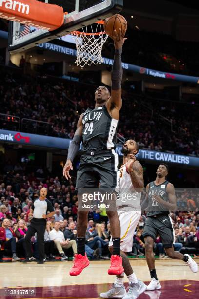Rondae HollisJefferson of the Brooklyn Nets shoots over JR Smith of the Cleveland Cavaliers during the second half at Quicken Loans Arena on October...