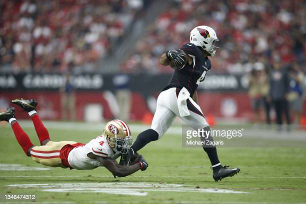 Rondale Moore of the Arizona Cardinals eludes a tackle from Emmanuel Moseley of the San Francisco 49ers during the game at State Farm Stadium on...