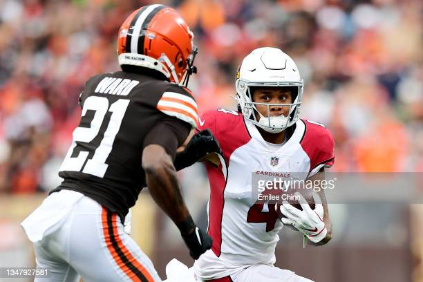 Rondale Moore of the Arizona Cardinals runs the ball against Denzel Ward of the Cleveland Browns during a game at FirstEnergy Stadium on October 17,...