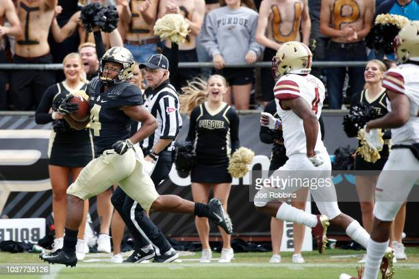 Rondale Moore of the Purdue Boilermakers runs downfield for a 70yard touchdown after catching a pass in the second quarter of the game against the...