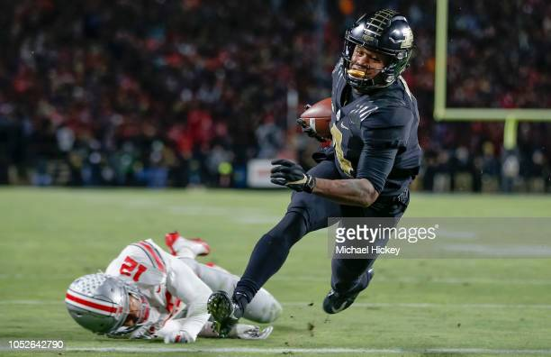 Rondale Moore of the Purdue Boilermakers runs into the end zone for a touchdown during the second quarter as Sevyn Banks of the Ohio State Buckeyes...