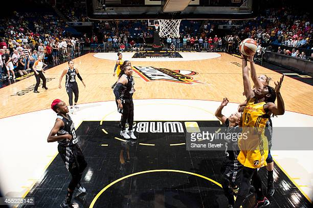 Roneeka Hodges of the Tulsa Shock battles for a rebound against the San Antonio Stars during the WNBA game on August 8 2014 at the BOK Center in...