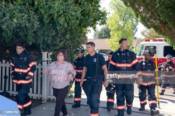 Ronen Rubenstein guest star Patrika Darbo Julian Works Rob Lowe Natacha Karam Jim Parrack and Brian Michael Smith in the YeeHaw episode of 911 LONE...