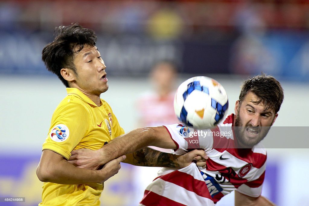 Rong Hao #33 of Guangzhou Evergrande and Antony Golec #35 of Western Sydney Wanderers battle for the ball during the Asian Champions League quarter-final match between Guangzhou Evergrande and Western Sydney Wanderers at Tianhe Sports Center on August 27, 2014 in Guangzhou, China.