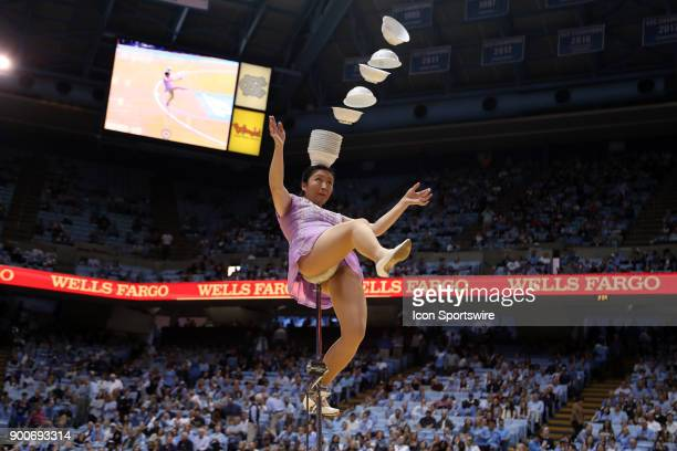 Rong Niu better known as Red Panda performs her unicycle and bowl balancing act at halftime during the North Carolina Tar Heels game versus the...