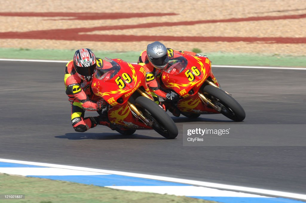 Rong Zai Su and Chi Fung Ho (CHN) during training for the 2006 Estoril Moto GP in Estoril, Portugal on October 14, 2006.