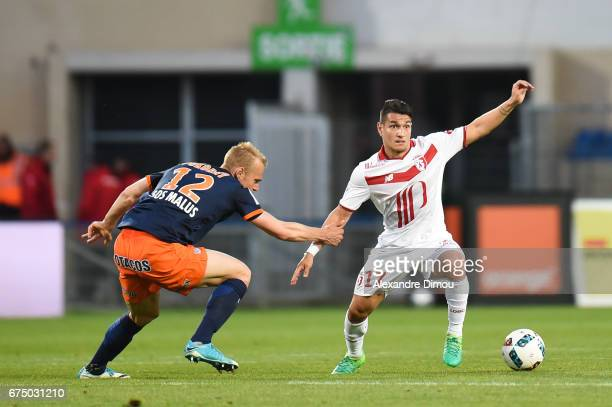 Roni Lopes of Lille and Lukas Pokorny of Montpellier during the French Ligue 1 match between Montpellier and Lille at Stade de la Mosson on April 29...