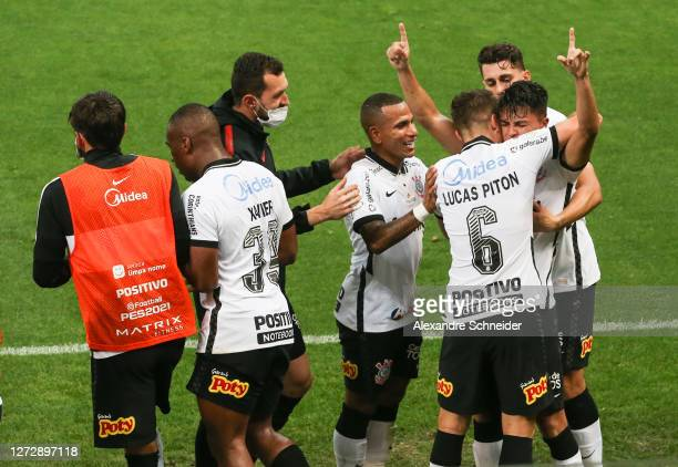 Roni of Corinthians celebrates with his team mates after scoring the second goal of their team during the match against Bahia as part of Brasileirao...