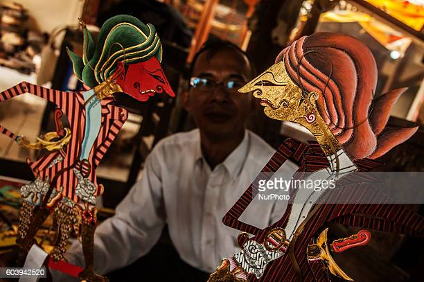 Roni Sodewo show shadow puppet known as ' wayang ' in Yogyakarta Indonesia on September 7 2016 Shadow puppet has been recognized as a world cultural...