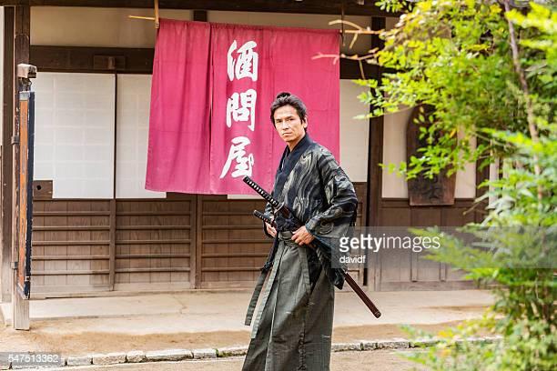 ronin samurai warrior with katana in a traditional japanese village - 村 ストックフォトと画像