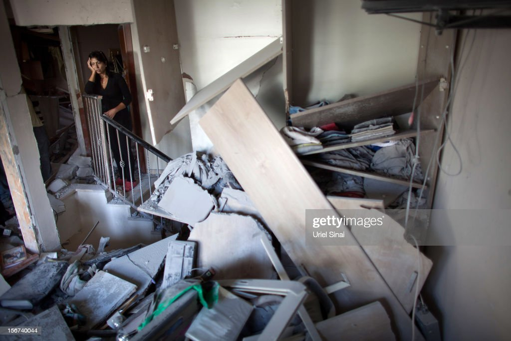 Ronit Hachmon inspects her house after it was hit by a rocket fired from the Gaza Strip on November 20, 2012 in Beersheba, Israel. Hamas militants and Israel are continuing talks aimed at a ceasefire as the death toll in Gaza reaches over 100 with three Israelis also having been killed by rockets fired by Palestinian militants.