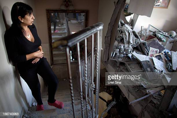 Ronit Hachmon inspects her house after it was hit by a rocket fired from the Gaza Strip on November 20 2012 in Beersheba Israel Hamas militants and...