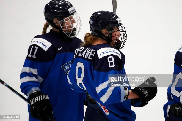 Ronja Savolainen of Finland celebrates her first period goal with Petra Nieminen while playing Germany in the bronze medal game at the 2017 IIHF...