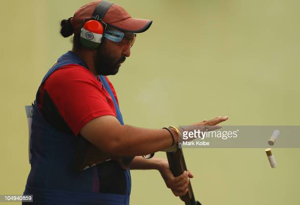 Ronjan Sodhi of India competes in the men's double trap at the Dr Karni Singh Shooting Range during day four of the Delhi 2010 Commonwealth Games on...