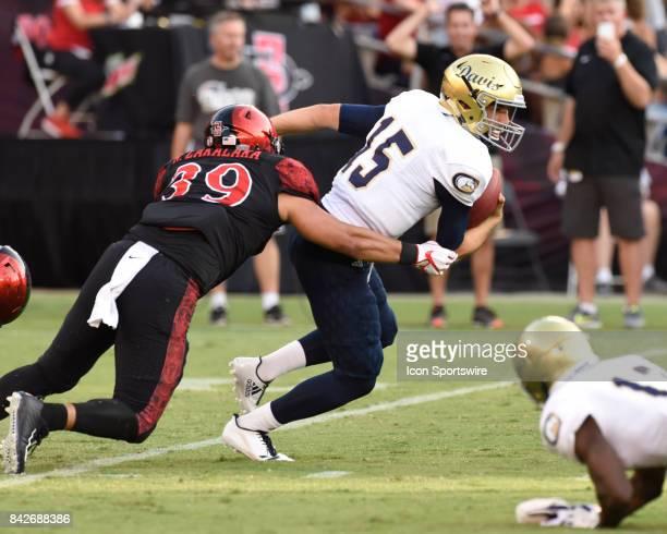 SDSU Ronley Lakalaka sacks UC Davis Jake Maier during the college football game between UC Davis Aggies and San Diego State University Aztecs on...
