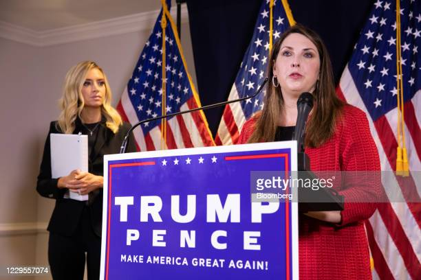 Ronna McDaniel, chairwoman of the Republican National Committee, speaks while Kayleigh McEnany, White House press secretary, left, listens during a...