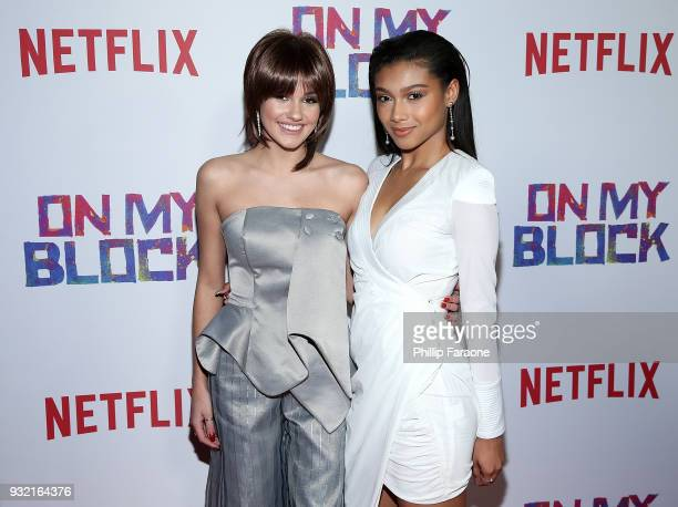 Ronni Hawk and Sierra Capri attend the premiere of Netflix's 'On My Block' at NETFLIX on March 14 2018 in Los Angeles California