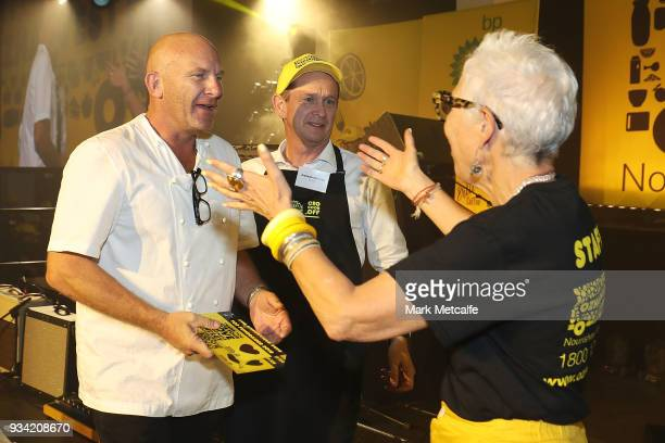 Ronni Kahn CEO and founder of OzHarvest greets Chef Matt Moran during the Oz Harvest CEO Cookoff on March 19 2018 in Sydney Australia