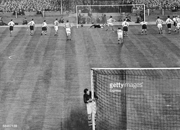 Ronnie Allen of West Bromwich Albion scores a penalty during the FA Cup final against Preston North End at Wembley 1st May 1954 WBA goalkeeper Jimmy...