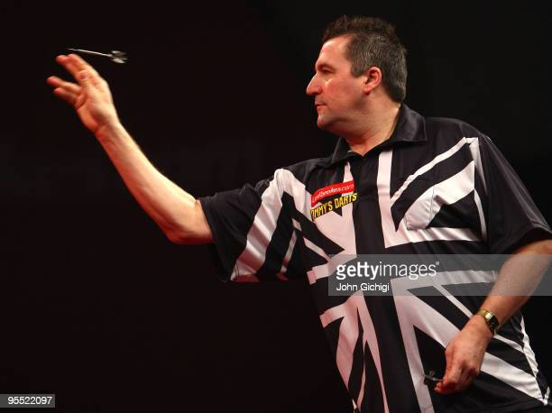 Ronnie Baxter of England in action against Raymond Van Barneveld of Netherlands during the Quarter Finals of the 2010 Ladbrokescom World Darts...