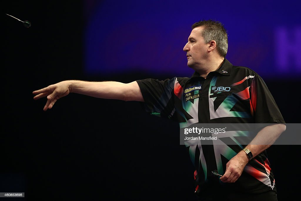 Ronnie Baxter of England in action in his second round match against Robert Thornton of Scotland during Day Seven of the William Hill PDC World Darts Championships at Alexandra Palace on December 27, 2014 in London, England.