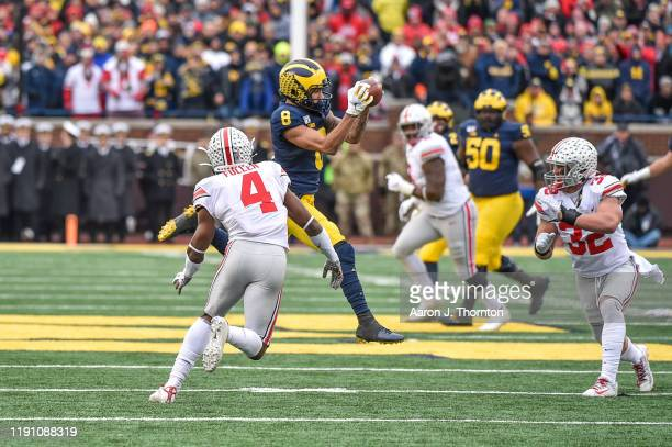 Ronnie Bell of the Michigan Wolverines catches a pass during the first half of a college football game against the Ohio State Buckeyes at Michigan...