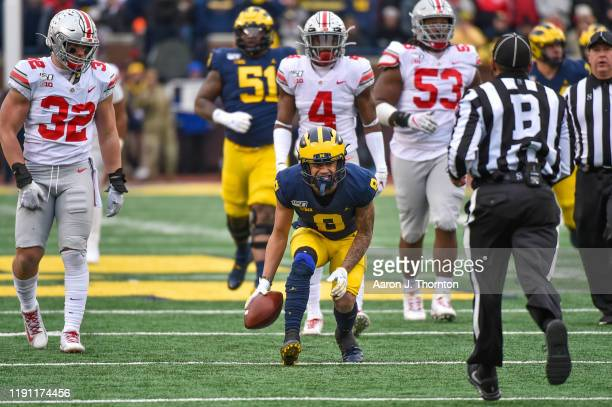 Ronnie Bell of the Michigan Wolverines celebrates a first down catch during the first half of a college football game against the Ohio State Buckeyes...