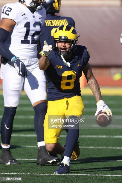 Ronnie Bell of the Michigan Wolverines celebrates a first half first down against the Penn State Nittany Lions at Michigan Stadium on November 28,...