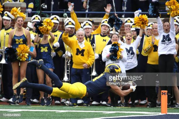 Ronnie Bell of the Michigan Wolverines dives for a first half touchdown while playing the Maryland Terrapins on October 6 2018 at Michigan Stadium in...