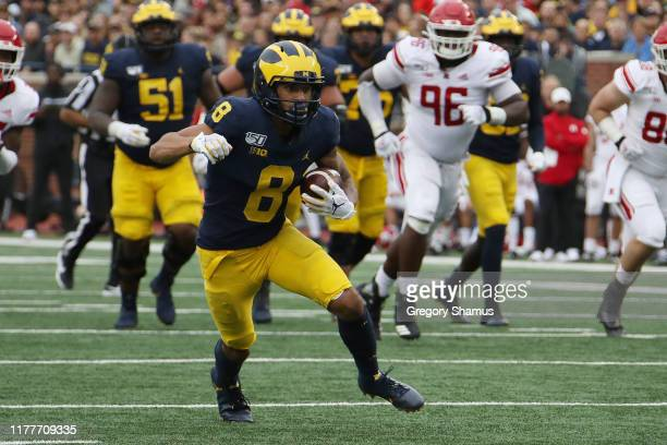 Ronnie Bell of the Michigan Wolverines looks for extra yards after a third quarter catch at Michigan Stadium on September 28 2019 in Ann Arbor...