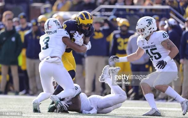 Ronnie Bell of the Michigan Wolverines makes the catch and runs for a first down during the third quarter of the game against the Michigan State...