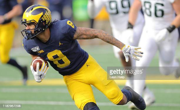 Ronnie Bell of the Michigan Wolverines makes the catch for a first down during the first quarter of the game against the Michigan State Spartans at...