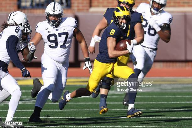 Ronnie Bell of the Michigan Wolverines runs after a first half catch against the Penn State Nittany Lions at Michigan Stadium on November 28, 2020 in...