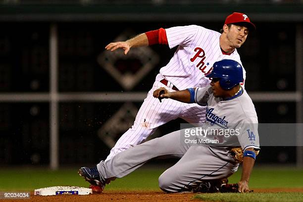 Ronnie Belliard of the Los Angeles Dodgers slides as he safely steals second base against the tag attempt by Chase Utley of the Philadelphia Phillies...