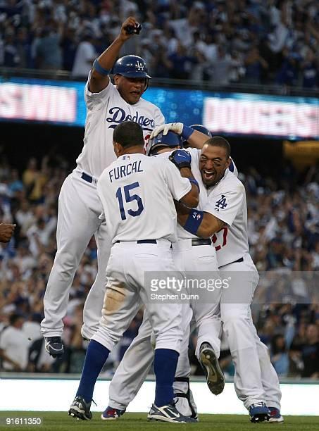 Ronnie Belliard, Rafael Furcal, Mark Loretta and Matt Kemp of the Los Angeles Dodgers celebrate after Loretta hit a walk-off RBI to defeat the St....
