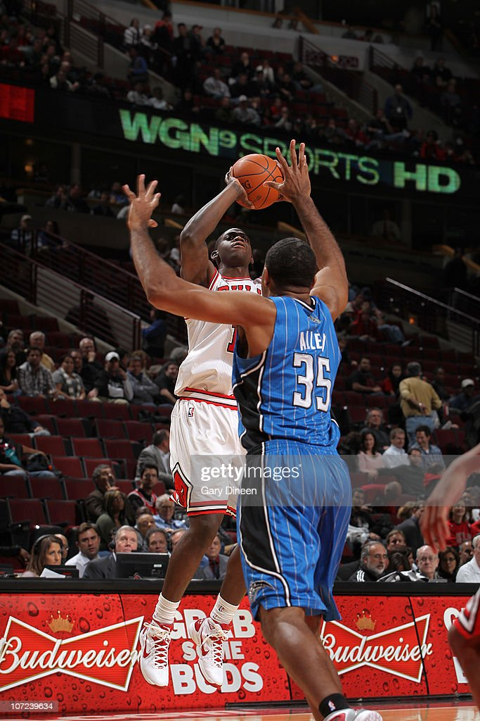 Ronnie Brewer #11 of the Chicago Bulls puts up a shot over Malik Allen #35 of the Orlando Magic during the NBA game on December 1, 2010 at the United Center in Chicago, Illinois.
