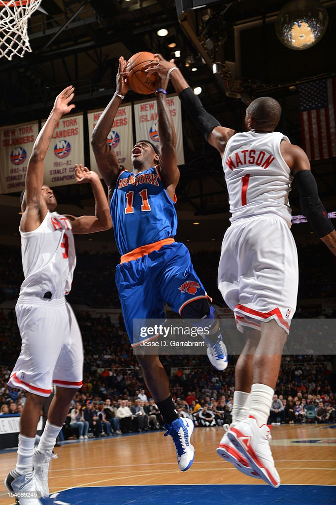 Ronnie Brewer #11 of the New York Knicks drives to the basket against C.J. Watson #1 of the Brooklyn Nets during the game at the Nassau Veterans Memorial Coliseum on October 24, 2012 in Long Island, New York.