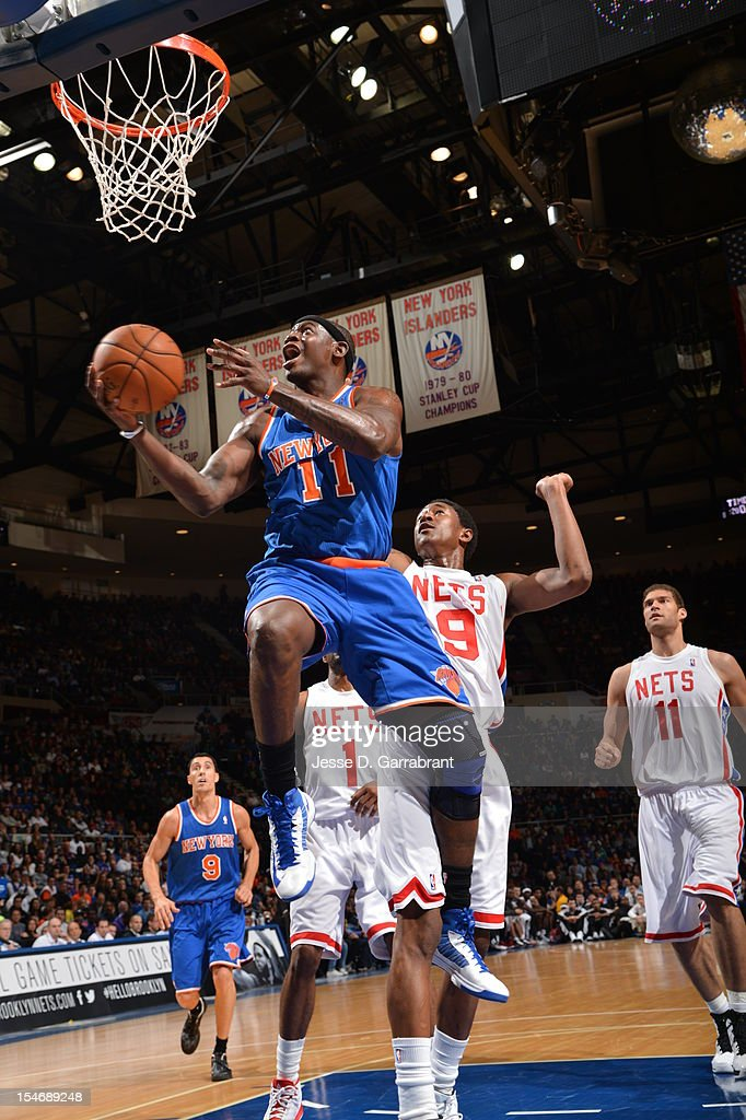 Ronnie Brewer #11 of the New York Knicks drives to the basket against MarShon Brooks #9 of the Brooklyn Nets during the game at the Nassau Veterans Memorial Coliseum on October 24, 2012 in Long Island, New York.