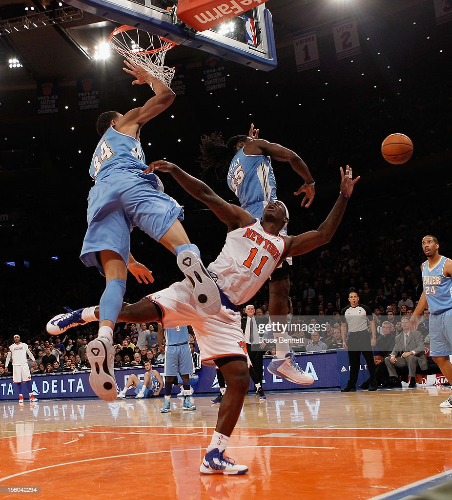 Ronnie Brewer #11 of the New York Knicks is fouled by JaVale McGee #34 of the Denver Nuggets at Madison Square Garden on December 9, 2012 in New York City.