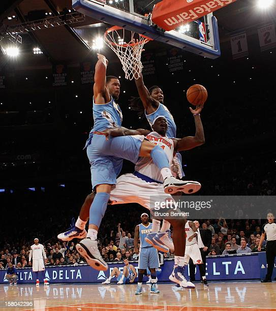 Ronnie Brewer of the New York Knicks is fouled by JaVale McGee of the Denver Nuggets at Madison Square Garden on December 9 2012 in New York City...