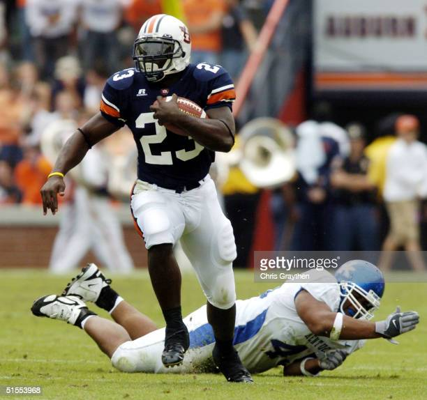 Ronnie Brown of Auburn Tigers avoids a tackle by Lamar Mills of Kentucky Wildcats on October 23 2004 at JordanHare stadium in Auburn Alabama Auburn...