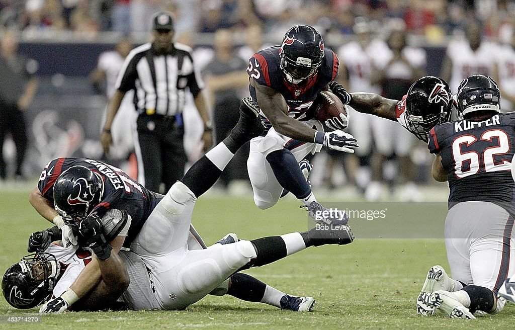 Ronnie Brown #22 of the Houston Texans runs up the middle against the Atlanta Falcons in the third quarter in a pre-season NFL game on August 16, 2014 at NRG Stadium in Houston, Texas.