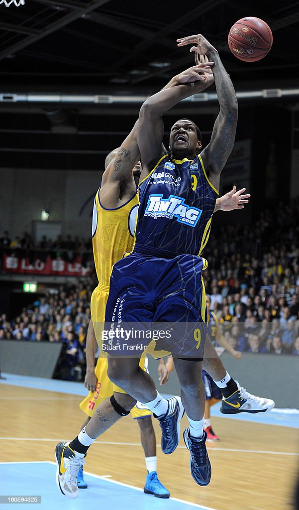 Ronnie Burrell of Oldenburg challenges for the ball with Deon Thompson of Berlin during the BBL game between EWE Baskets Oldenburg and Alba Berlin at the EWE arena on February 3, 2013 in Oldenburg in Holstein, Germany.