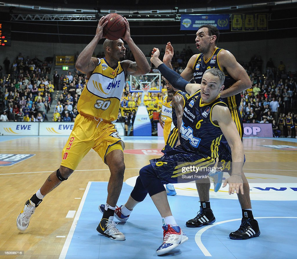 Ronnie Burrell of Oldenburg challenges for the ball with Sven Schultze of Berlin during the BBL game between EWE Baskets Oldenburg and Alba Berlin at the EWE arena on February 3, 2013 in Oldenburg in Holstein, Germany.