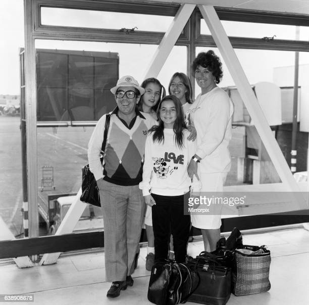 Ronnie Corbett and his wife Anne with children Emma, 13 and Sophie 11 and the children's nanny Debbie Oliver arriving at Heathrow Airport from Los...