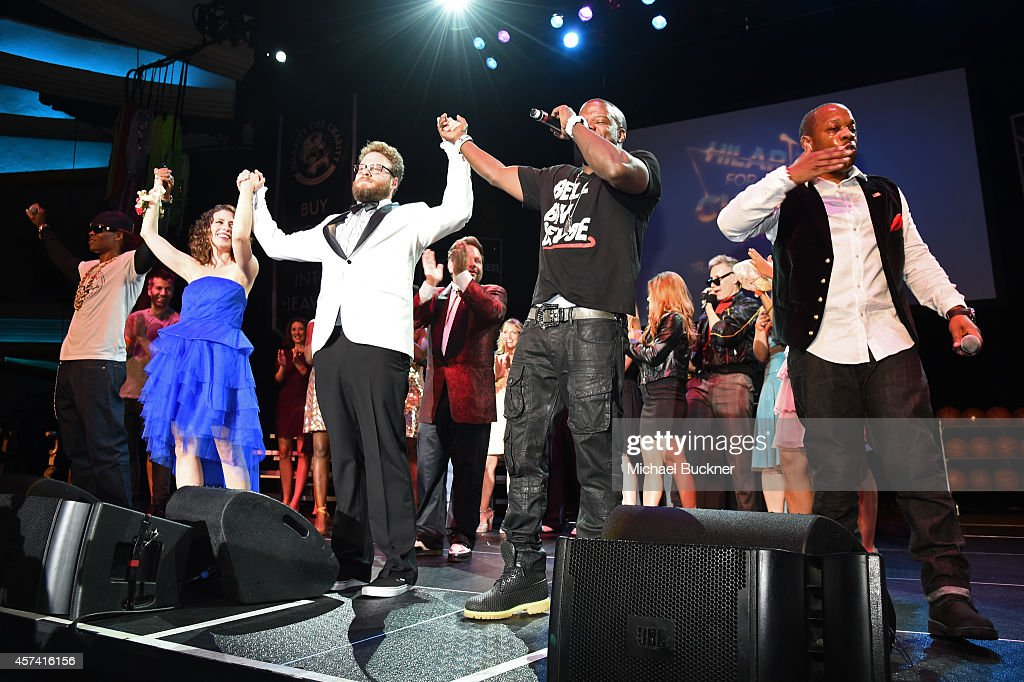 Ronnie DeVoe, Lauren Miller Rogen, Seth Rogen, Ricky Bell and Michael Bivins of Bell Biv DaVoe perform onstage during the 3rd Annual Hilarity for Charity Variety Show to benefit the Alzheimer's Association, presented by Genworth, at Hollywood Palladium on October 17, 2014 in Hollywood, California.
