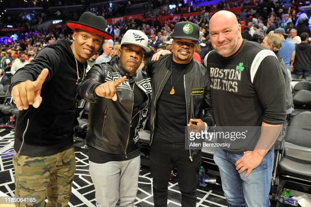 Ronnie DeVoe Michael Bivins Ricky Bell of Bell Biv DeVoe pose for a photo with Dana White after a basketball game between the Los Angeles Clippers...