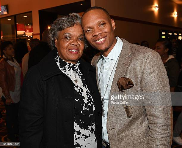 Ronnie Devoe of New Edition poses with his mother Flo Devoe at BET's Atlanta screening of The New Edition Story at AMC Parkway Pointe on January 5...