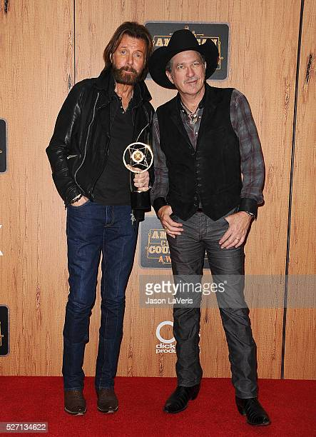 Ronnie Dunn and Kix Brooks of Brooks Dunn pose in the press room at the 2016 American Country Countdown Awards at The Forum on May 01 2016 in...